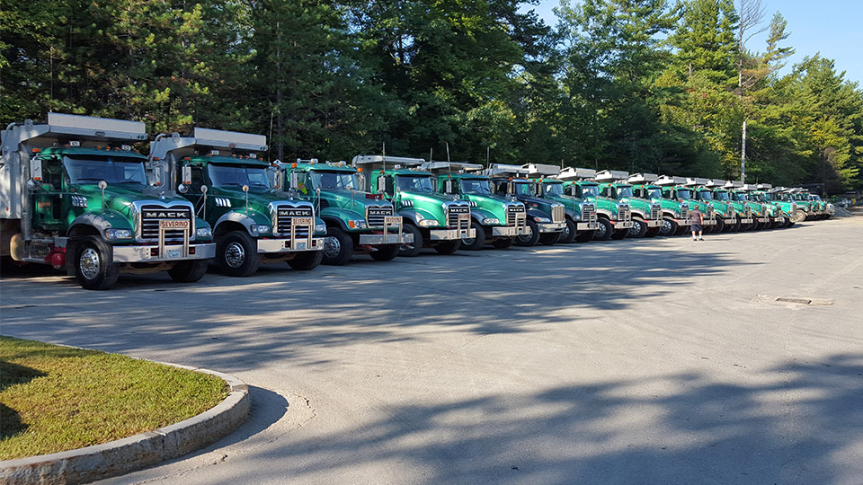 Lineup of Severino trucks in a parking lot